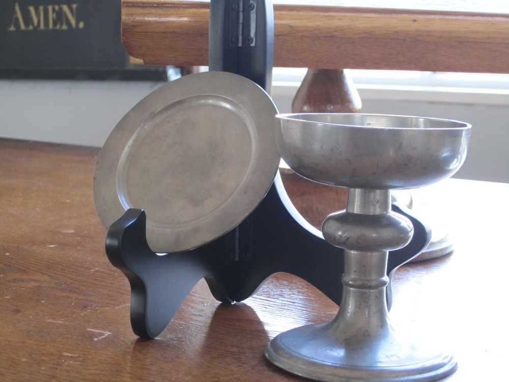 The small pewter chalice and paten are very old and were likely used as a traveling set by the rector. It is believed these were donated by John Bayard, a son of Colonel Samuel Baird of Wilmot.