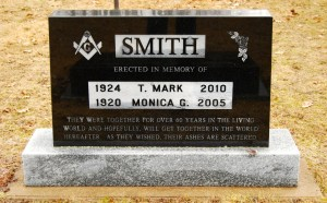 The gravestone of Mark Smith who sponsored the erection of the Memorial Wall pictured above.